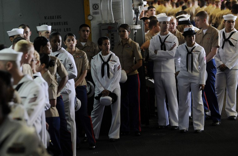 U.S. Marines and navy personnel prepare to line up and stand at the rails of the USS Wasp as the amphibious assault ship enters into New York Harbor for Fleet Week May 23, 2012. (Keith Bedford/Reuters)