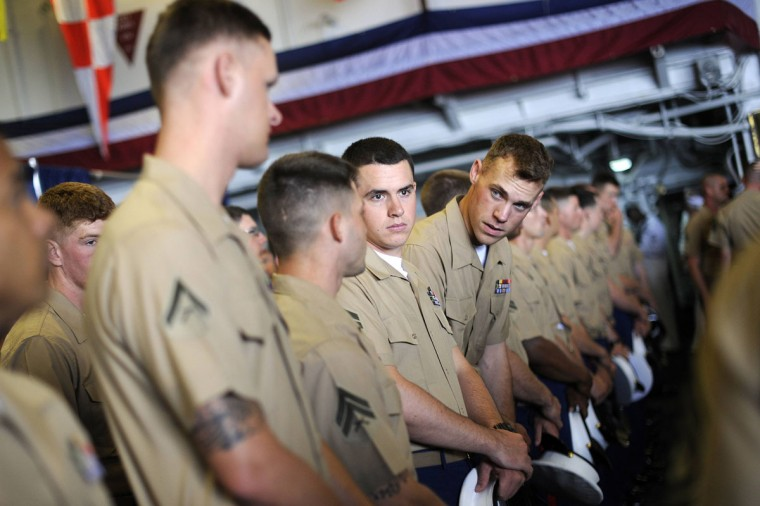U.S. Marines prepare to line up and stand at the rails of the USS Wasp as the amphibious assault ship enters into New York Harbor for Fleet Week May 23, 2012. (Keith Bedford/Reuters)