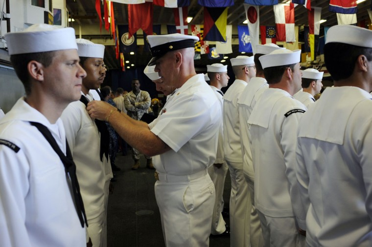 U.S. navy personnel have their uniforms inspected by a commanding officer of the USS Wasp as the amphibious assault ship enters into New York Harbor for Fleet Week May 23, 2012. (Keith Bedford/Reuters)