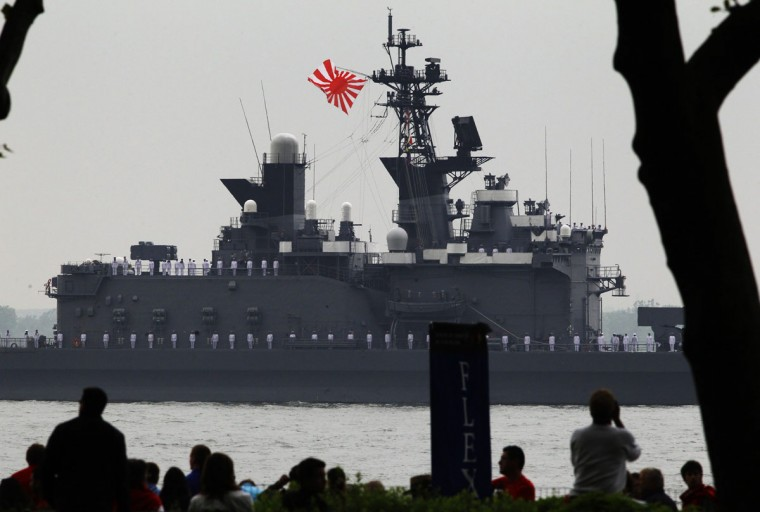 People watch as the Japanese Navy ship, JS Shirane, makes its way through the New York Harbor while arriving for the 25th annual Fleet Week celebration in New York, May 23, 2012. (Brendan McDermid/Reuters)