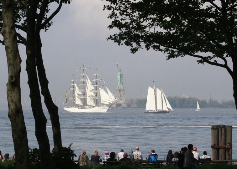 The tall ship Cisne Branco, (L) a Brazilian Navy ship, passes the Statue of Liberty in New York Harbor while arriving for the 25th annual Fleet Week celebration in New York, May 23, 2012. (Brendan McDermid/Reuters)