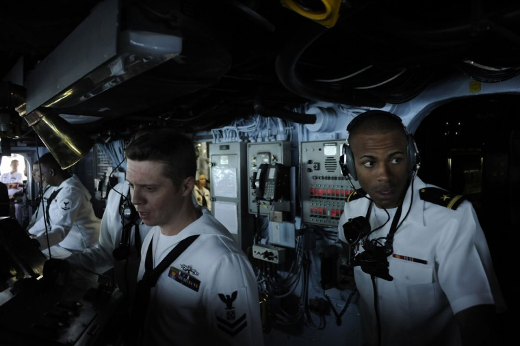 U.S. Navy personnel work on the bridge of the USS Wasp as the amphibious assault ship enters into New York Harbor for Fleet Week May 23, 2012. (Keith Bedford/Reuters)