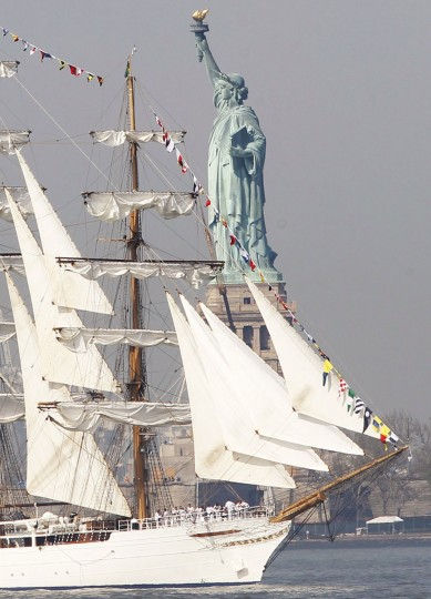 The tall ship Cisne Branco, a Brazilian Navy ship, passes the Statue of Liberty in New York Harbor while arriving for the 25th annual Fleet Week celebration in New York, May 23, 2012. (Brendan McDermid/Reuters)