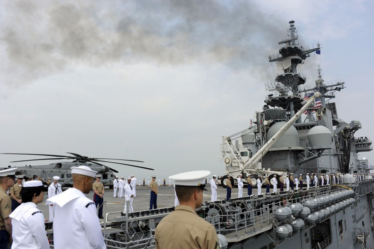 U.S. Marine Corps and navy personnel stand at the rails of the USS Wasp during its entry into the New York Harbor for Fleet Week May 23, 2012. (Keith Bedford/Reuters)