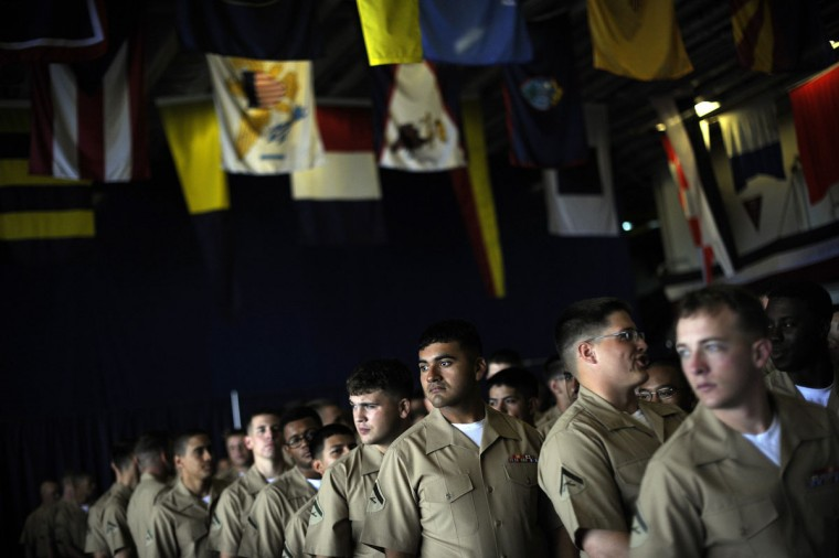 U.S. Marines prepare to line up and stand at the rails of the USS Wasp as the amphibious assault ship enters the New York Harbor for Fleet Week May 23, 2012. (Keith Bedford/Reuters)