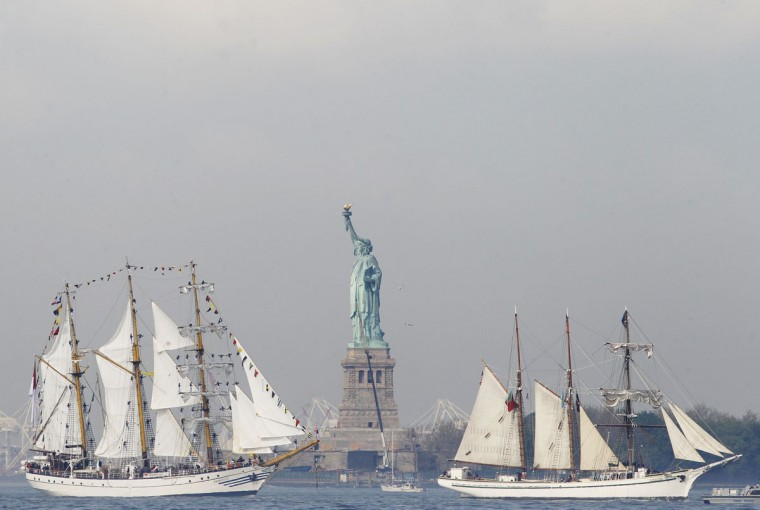 The tall ships KRI Dewaruci and Gazela pass the Statue of Liberty in New York Harbor, while arriving for the 25th annual Fleet Week celebration in New York, May 23, 2012. (Brendan McDermid/Reuters)