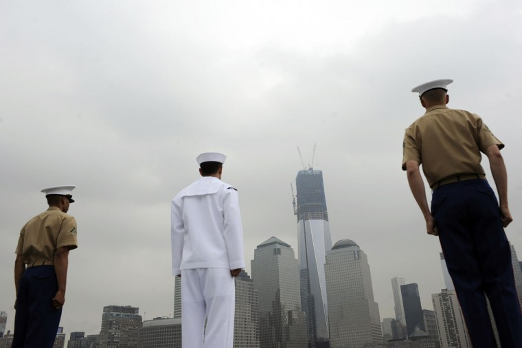 U.S. Marine Corps and navy personnel stand at the rails of the USS Wasp as the amphibious assault ship passes 1 World Trade Center during its entry into New York Harbor for Fleet Week May 23, 2012. (Keith Bedford/Reuters)