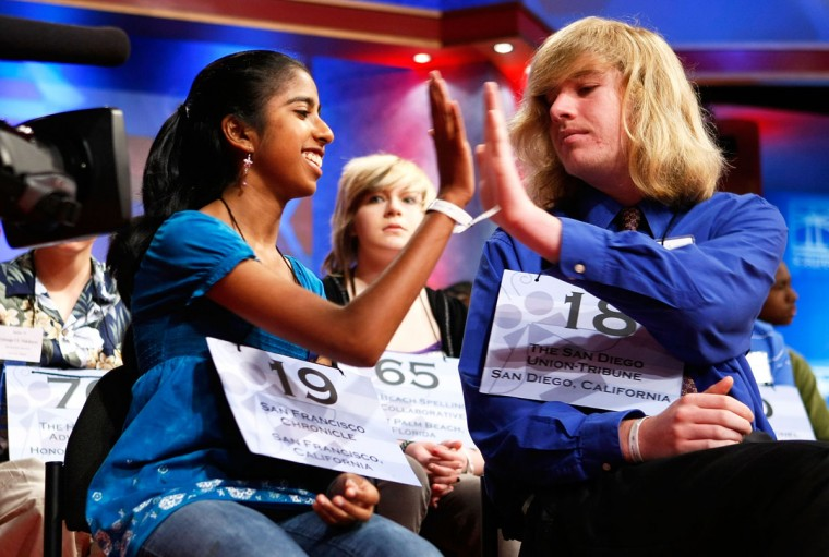 "May 28, 2009: Ramya Auroprem (L) of San Jose, California, hi-fives with Alex Clifton Wells (R) of San Diego, California, after she correctly spelled the word ""purlieu"" during round four of the 2009 Scripps National Spelling Bee competition in Washington, DC. (Alex Wong/Getty Images)"