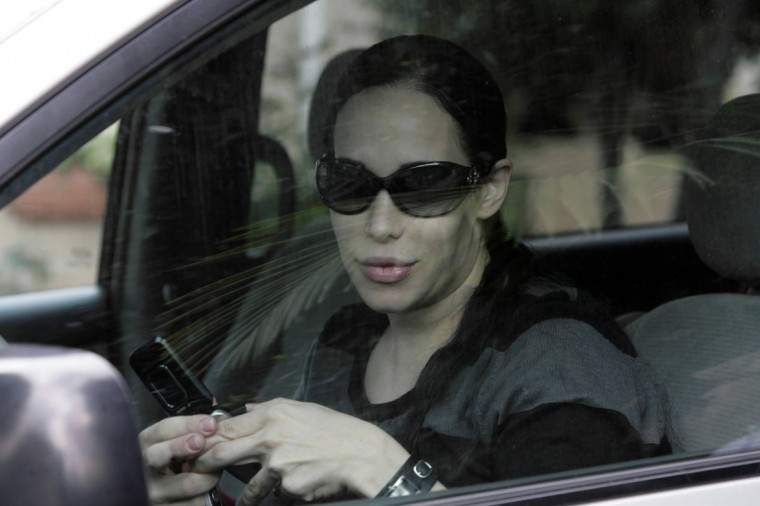 Nadya Suleman's fame began when she successfully birthed eight children in January of 2009, adding to six she already had at home. Since then, she has been actively trying to stay in the public eye through endorsement deals, talk show appearances and reality show attempts. Pictured: Nadya Suleman leaves her mother's home in Whittier, California on February 27, 2009. (Nick Ut/AP Photo)