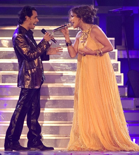 Before their divorce, and during their barely concealed pregnancy, Marc Anthony and Jennifer Lopez performed together on the opening night of their concert tour in Atlantic City, New Jersey on Sept. 28, 2007. (AP Photo/Tim Larsen)