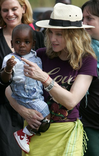 With the 2009 adoption of Mercy James, Madonna has four children total: Lourdes Leon, 15, Rocco Richie, 12, David, 6, and 5-year-old Mercy. Pictured: Madonna carries adopted son David Banda in her arms on April 19, 2007 at Consol Homes, a daycare center that she is funding in the village of Masekese, Malawi. Madonna was visiting a new daycare center that she is funding in Malawi, one of the world's poorest, most disease-stricken countries. (AP Photo/Karel Prinsloo)