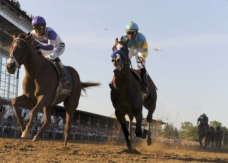 I'll Have Another (left) over-takes Bodemeister at the finish. (Gene Sweeney Jr./Baltimore Sun)