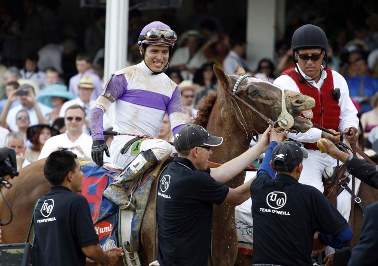 Mario Gutierrez aboard I'll Have Another celebrates after winning the 138th running of the Kentucky Derby at Churchill Downs. (Brian Spurlock/US Presswire)