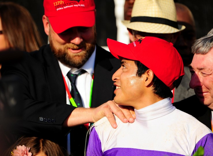 I'll Have Another trainer Doug F. O'Neill (left) congratulates jockey Mario Gutierrez (right) after winning the 137th running of the Preakness Stakes at Pimlico Race Course. (Evan Habeeb/US Presswire)