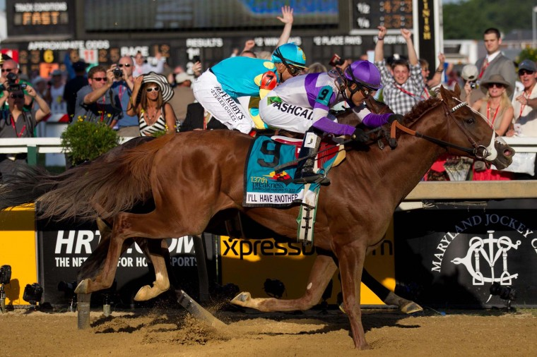Mario Gutierrez aboard I'll Have Another pulls past Mike Smith aboard Bodemeister to win the 137th running of the Preakness Stakes at Pimlico Race Course. (Maxwell Kruger/US Presswire)