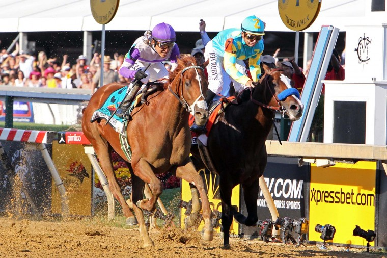 Mario Guttierez (9) aboard I'll Have Another wins the the 137th running of the Preakness Stakes at Pimlico Race Course. (Mitch Stringer/US Presswire)
