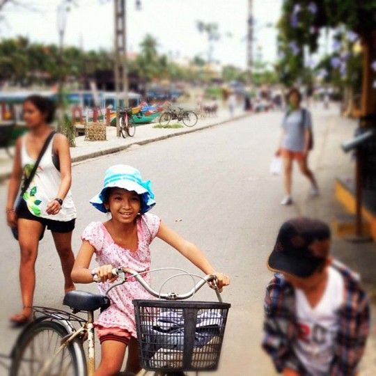 Locals near the river in Hoi An. (Credit: Scott and Pam Gorsuch)