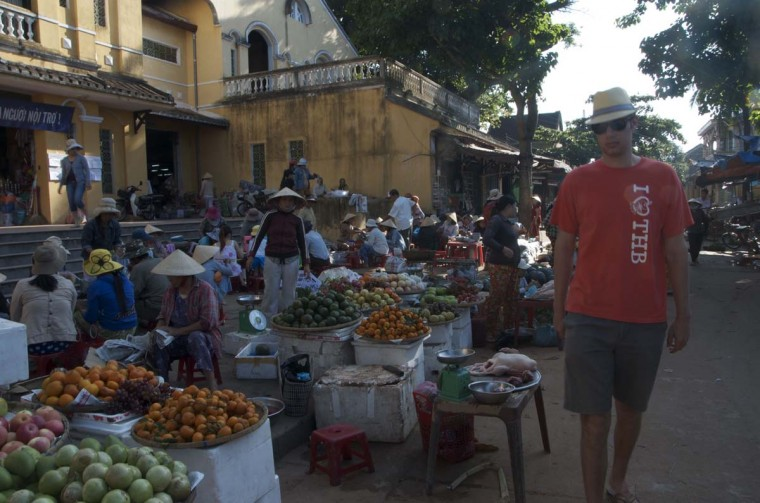 Passing produce being sold by locals in a market in Hoi An. (Credit: Scott and Pam Gorsuch)