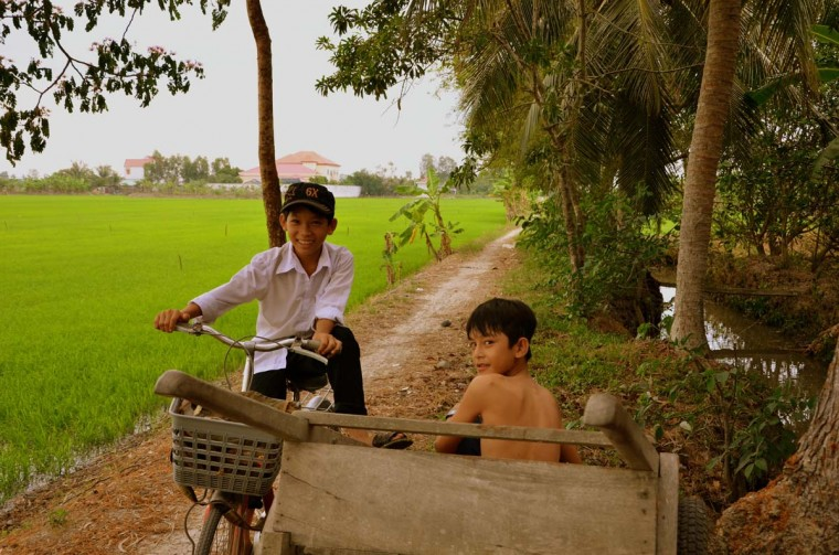 Kids in a village along Mekong Delta. (Credit: Scott and Pam Gorsuch)