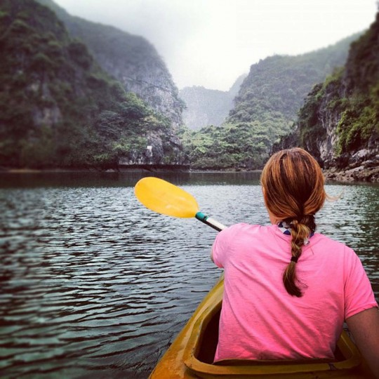 Next stop for the couple was Ha Long Bay. Above, Pam paddles a kayak. (Credit: Scott and Pam Gorsuch)