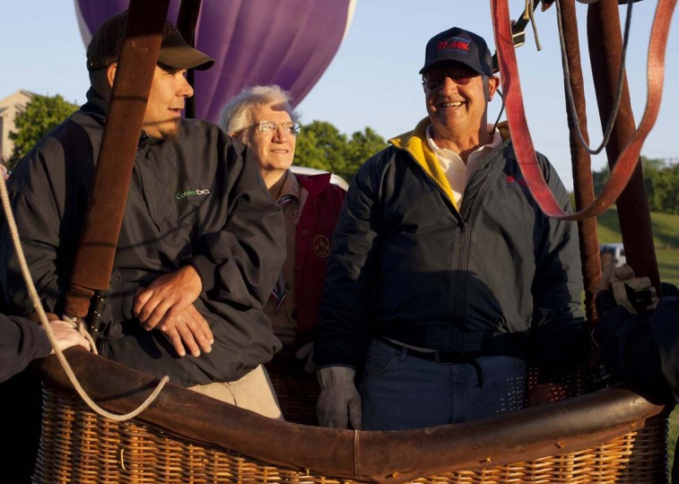 (L-R) Jeff Facto of Eldersburg, Chip Galloway of Ellicott City and Kevin Poeppelman of Clarksburg inflate the Remax balloon. (Sarah Pastrana/Patuxent Homestead)