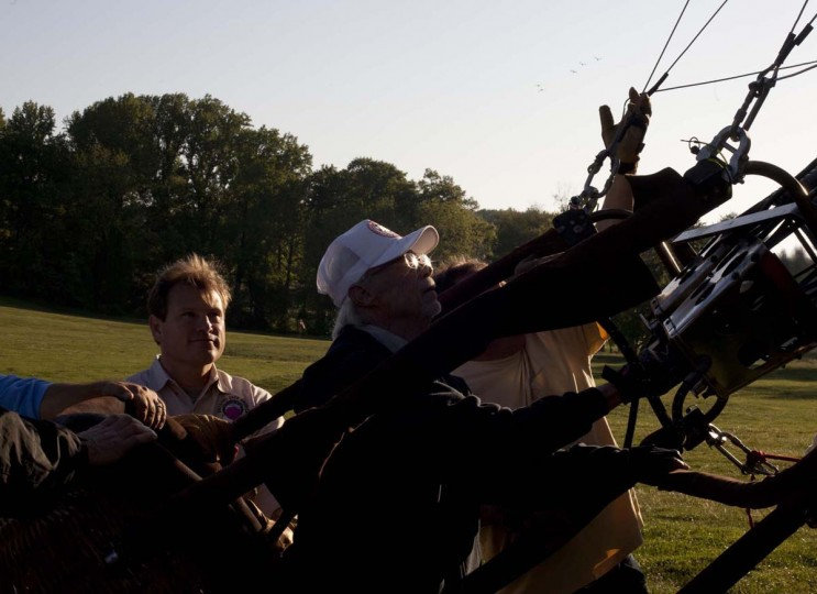 Mark Meyer, left, of Westminster holds the wicker basket of Spunky, while pilot John Cavin of Menlo, Ga. inflates his balloon. (Sarah Pastrana/Patuxent Homestead)