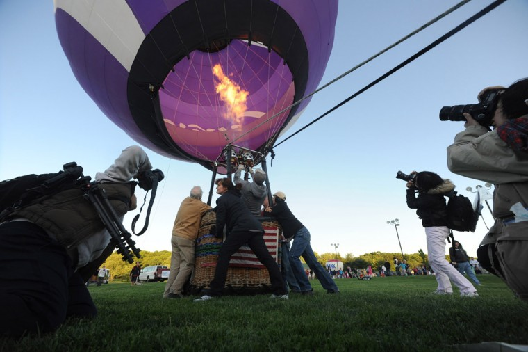 Visitors takes pictures as a crew inflates a balloon while battling the wind. (Brian Krista/Patuxent Homestead)