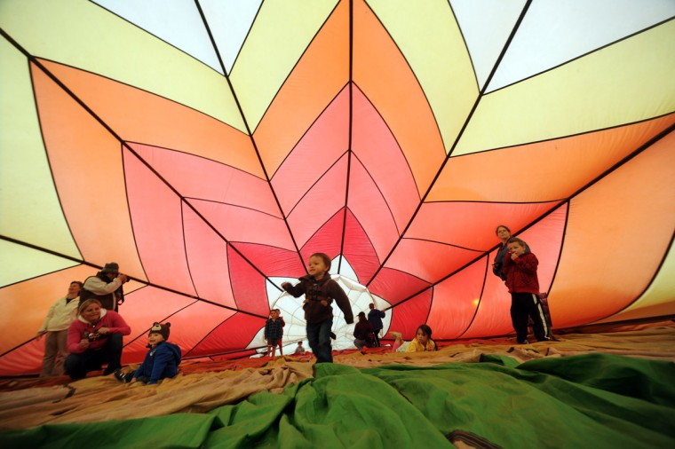 Children play inside a walkabout balloon, retired from flying. (Brian Krista/Patuxent Homestead)