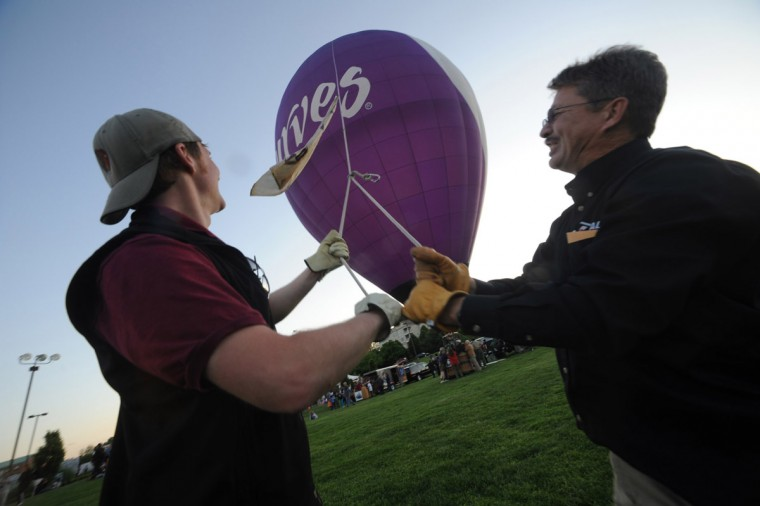 Nate Wilson of Dansville, N.Y., left, and Bill Sisler of Westminster hold tightly to a rope as they keep a balloon from blowing in the wind. (Brian Krista/Patuxent Homestead)