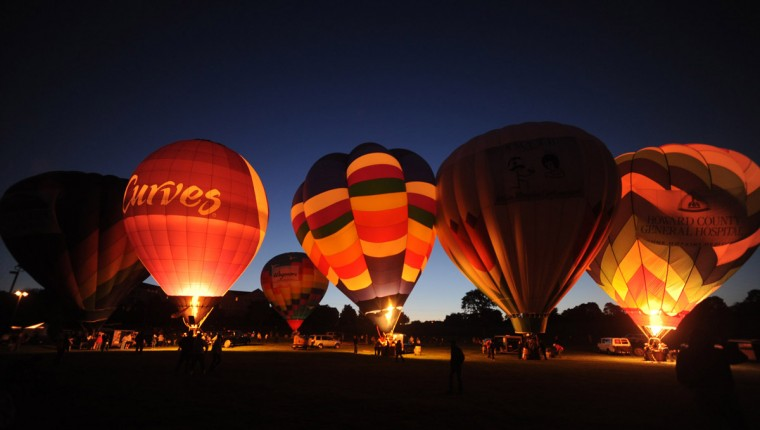 "Hot air balloon operators take part in the evening ""glow."" (Brian Krista/Patuxent Homestead)"