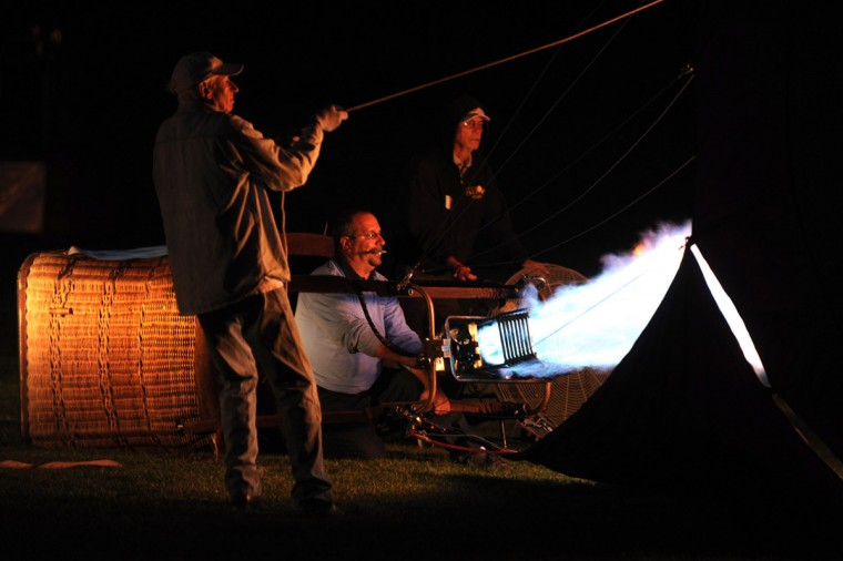 A crew prepares their balloon in the dark. (Brian Krista/Patuxent Homestead)