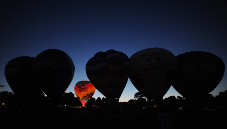 The first balloon lights up for the evening glow. (Brian Krista/Patuxent Homestead)