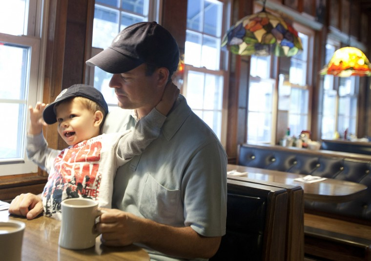 Andrew Hays, 3, of Columbia and his father, Guerin Hays, wait for their breakfast at the Forest Diner on May 21. The diner has served customers in Ellicott City since 1946, but will close on May 28. The servers and kitchen staff will work across the street at Jilly's, which will begin serving breakfast after the diner closes. (Sarah Pastrana/Patuxent Homestead)