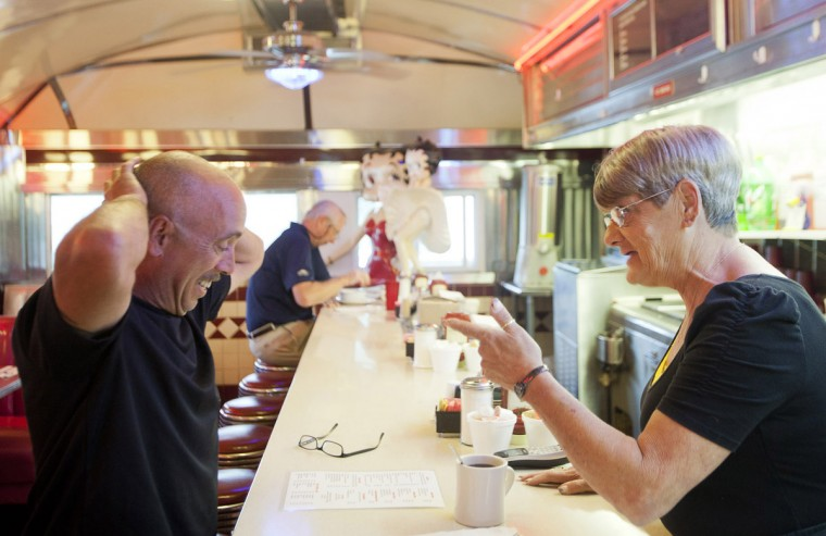 Waitress Ellen Jackson, of Ellicott City, jokes with Albert Stokes, of Annapolis, on May 21. Jackson has been working at the diner since 1994. Although she works six days a week, she says she almost always stops by on her day off to see friends. (Sarah Pastrana/Patuxent Homestead)