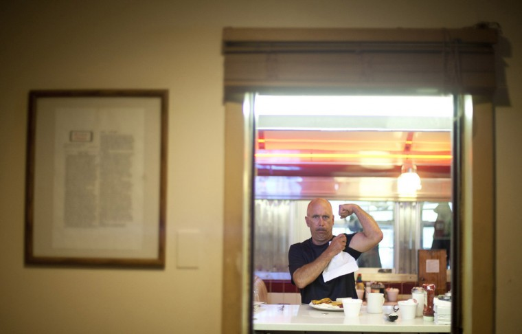 Albert Stokes, of Annapolis, jokingly shows off his muscles while eating breakfast at the Forest Diner. Stokes has been eating at the diner since he moved to the area in 1983. The Forest Diner is an original Silk City dining car that has dished out coffee and eggs in Howard County since 1946, but additions have been added to the original diner in recent years. The diner will close at the end of the day on May 28. (Sarah Pastrana/Patuxent Homestead)