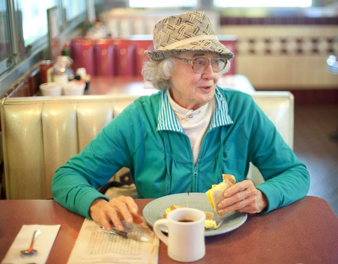 Mary Ellen Peters, of Ellicott City, has been a regular at the Forest Diner since 1990, but she first visited the diner in 1948. On the morning of May 21, she worked on a crossword puzzle while chatting with other regulars. (Sarah Pastrana/Patuxent Homestead)