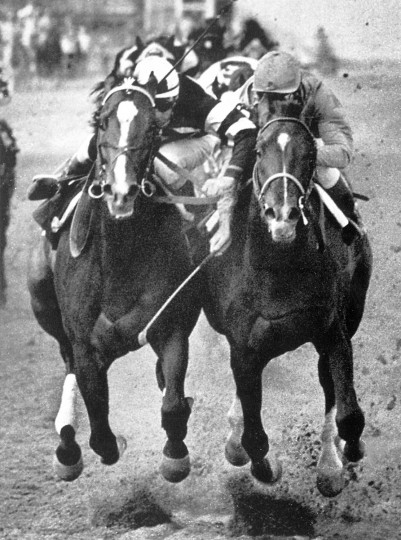 In this prize winning photo finish from the 1962 Preakness, Greek Money, right, ridden by Johnny Rotz beats Ridan, ridden by Manuel Ycaza, left. (Joseph A. DiPaola/Baltimore Sun)