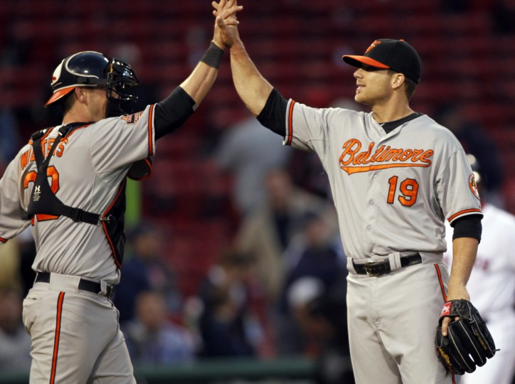 Baltimore Orioles first baseman Chris Davis (19) celebrates with catcher Matt Wieters (32) after defeating the Boston Red Sox 9-6. Chris Davis, normal a first baseman came in and pitched a scoreless 16th and 17th inning to take the win. (Greg M. Cooper/USPW photo)