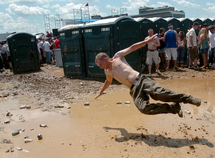 A Preakness goer dives into the infield mud during the 2005 race. (Glenn Fawcett/Baltimore Sun)