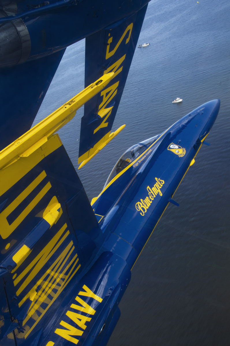 "Capt. Brandon Cordill, left wingman of the U.S. Navy flight demonstration squadron, the Blue Angels, flies with the canopy of his F/A-18 Hornet approximately 18 inches from the wingtip of Capt. Greg McWherter during the Òdiamond 360Ó maneuver over Baltimore's Inner Harbor during the Star Spangled Sailabration. The Sailabration coincides with Baltimore Fleet Week 2012 and commemorates the War of 1812 and the writing of the ""Star Spangled Banner"" (U.S. Navy photo by Mass Communication Specialist 2nd Class Andrew Johnson)"
