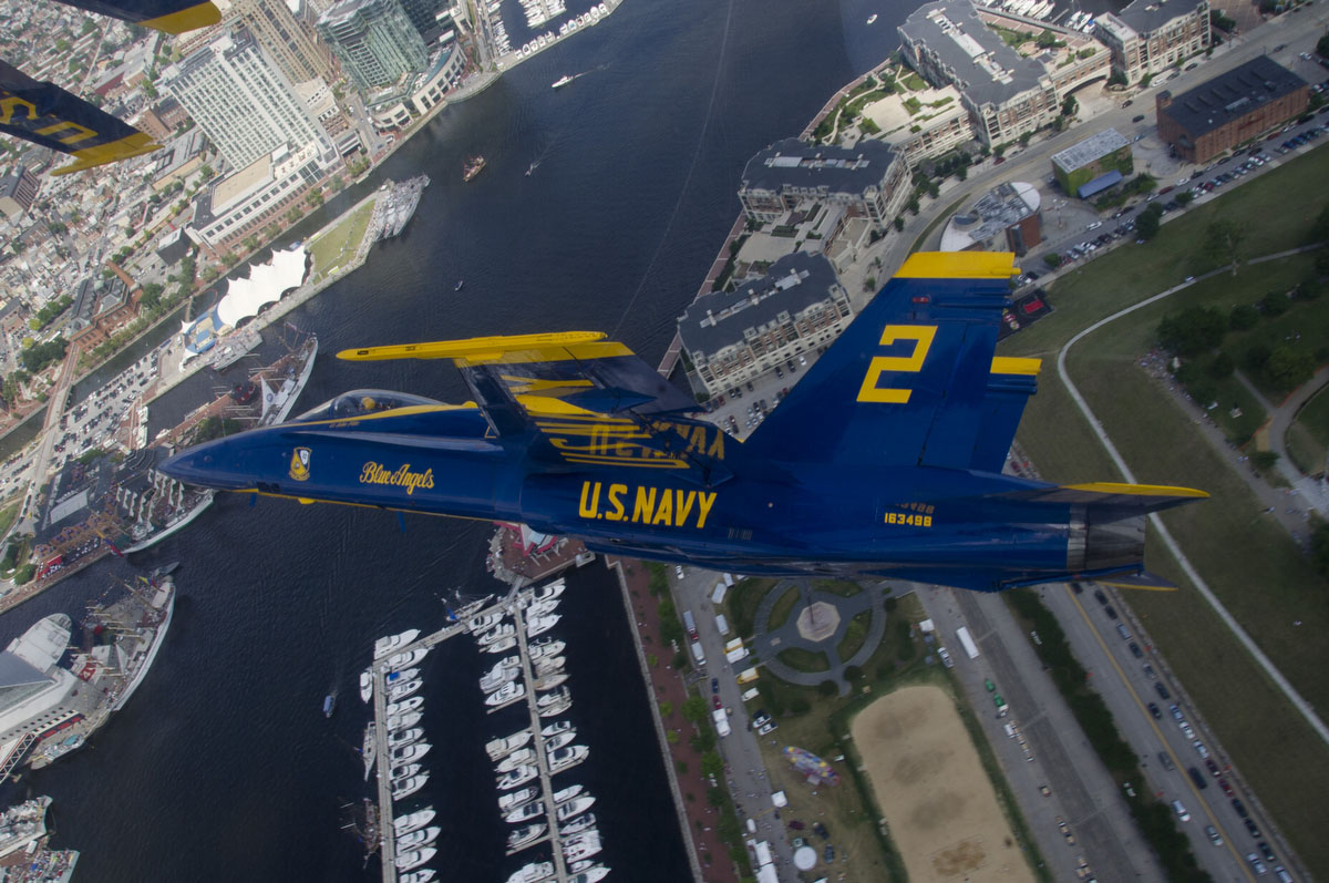 "Lt. John Hiltz, right wingman of the U.S. Navy flight demonstration squadron, the Blue Angels, flies an F/A-18 Hornet over Baltimore during the Star Spangled Sailabration, which coincides with Baltimore Fleet Week 2012 and commemorates the War of 1812 and the writing of the ""Star Spangled Banner."" (U.S. Navy photo by Mass Communication Specialist 2nd Class Andrew Johnson)"