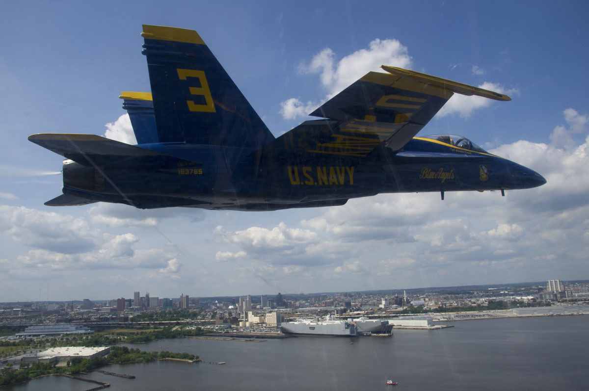 "Capt. Brandon Cordill, left wingman of the U.S. Navy flight demonstration squadron, the Blue Angels, flies an F/A-18 Hornet over Baltimore during the Star Spangled Sailabration, which coincides with Baltimore Fleet Week 2012 and commemorates the War of 1812 and the writing of the ""Star Spangled Banner."" (U.S. Navy photo by Mass Communication Specialist 2nd Class Andrew Johnson)"