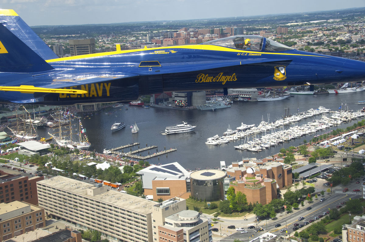 "Lt. C.J. Simonsen, lead solo pilot of the U.S. Navy Flight Demonstration Squadron, the Blue Angels, flies an F/A-18 Hornet over Baltimore during the Star Spangled Sailabration, which coincides with Baltimore Fleet Week 2012 and commemorates the War of 1812 and the writing of the ""Star Spangled Banner."" (U.S. Navy photo by Mass Communication Specialist 2nd Class Andrew Johnson)"