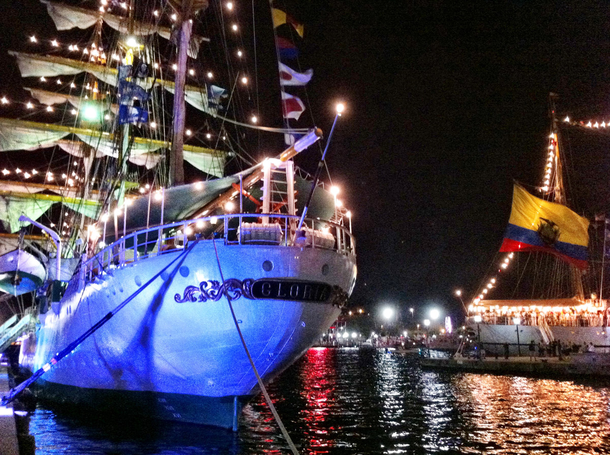 View of the stern of the lit up ARC Gloria with the light-up BAE Guayas in the background near Pier IV in the Inner Harbor. (Nick Tann/Baltimore Sun)