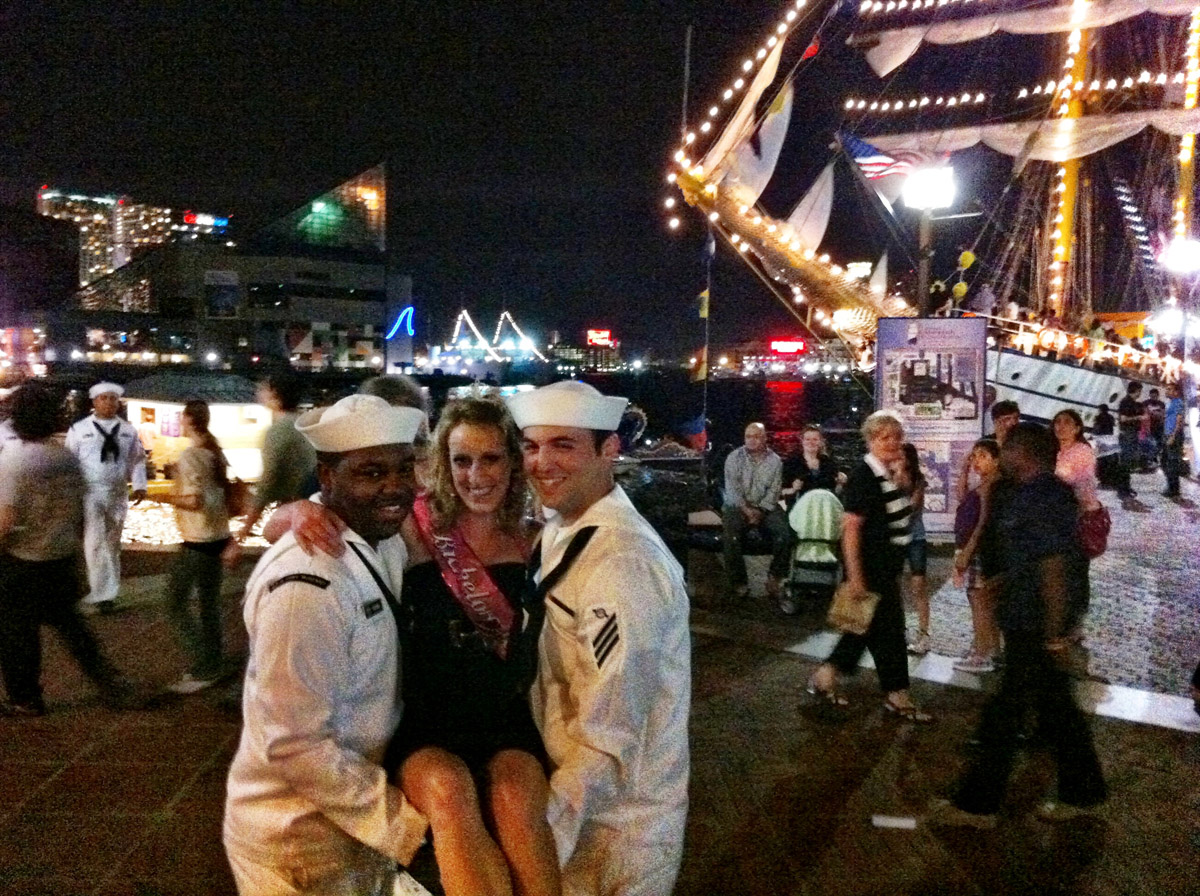 A bachelorette getting attention from the sailors in the Inner Harbor. (Nick Tann/Baltimore Sun)