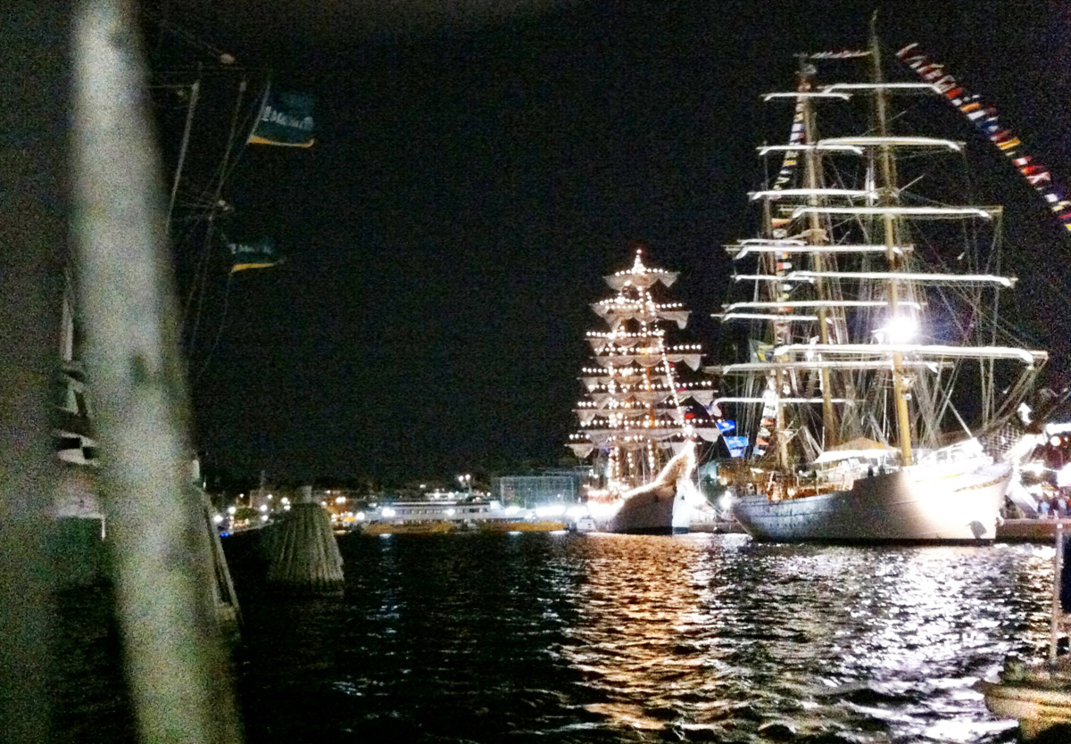 Lit up tall ships along the west side of the Inner Harbor with the USS Constellation slightly visible to the left in the foreground. (Nick Tann/Baltimore Sun)