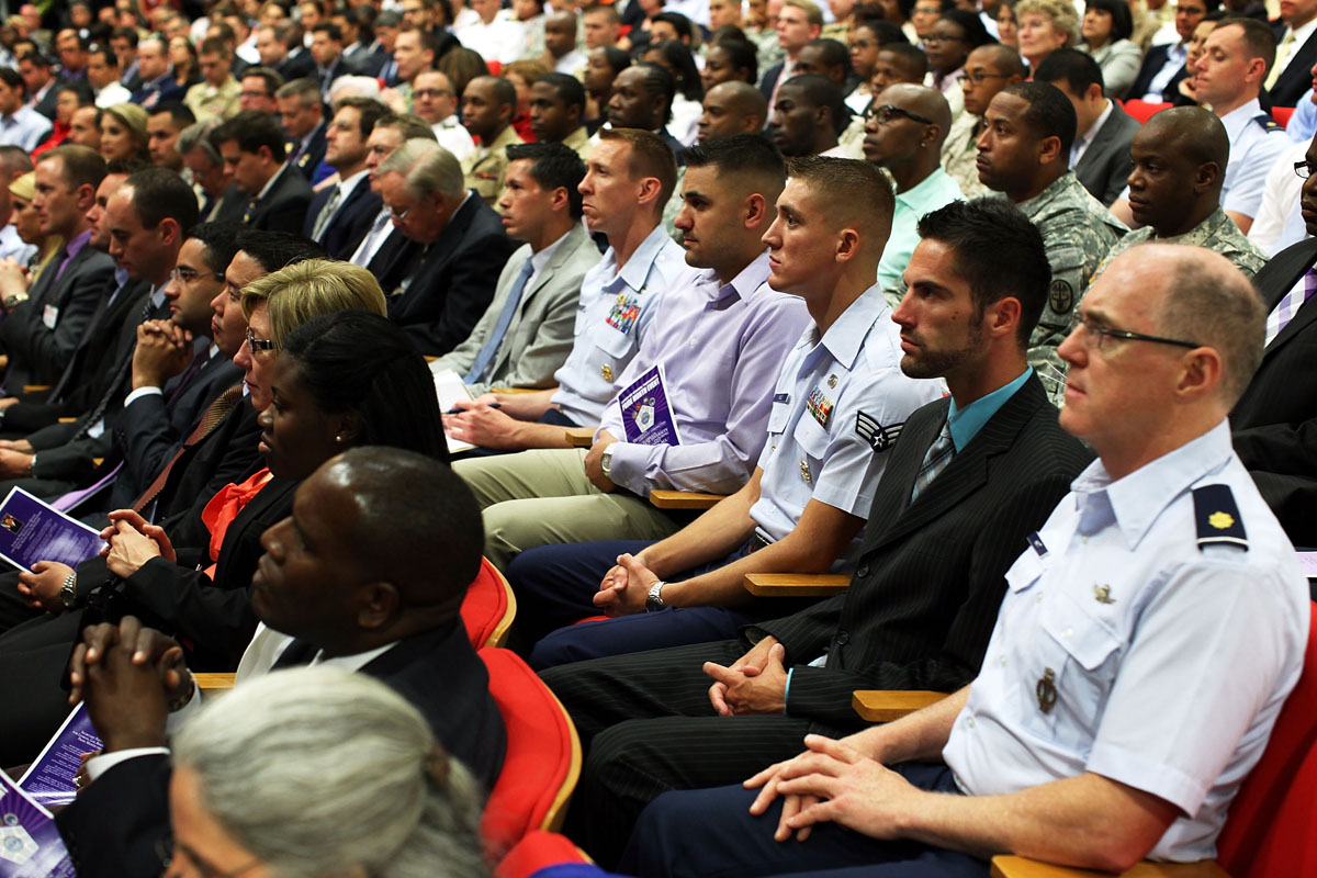 """Washington D.C.: Members of the audience listen during an event to observe the """"Lesbian, Gay, Bisexual and Transgender Pride Month"""" June 26, 2012 at the Pentagon in Arlington, Virginia. It was the first-ever LGBT event held at the Pentagon. (Alex Wong/Getty Images)"""