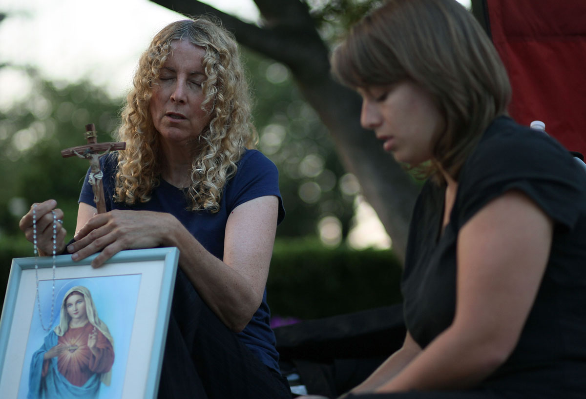 June 28, 2012: Carol Anderson (L), and Jamie Sammon (R), pray in front of the U.S. Supreme Court on June 28, 2012 in Washington, DC. Today the high court is expected to rule on the constitutionality of the sweeping health care law championed by President Barack Obama. (Mark Wilson/Getty Images)