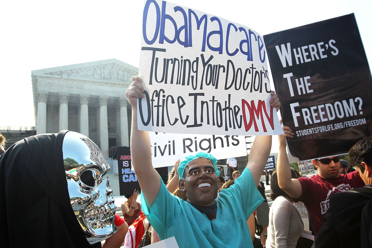 June 28, 2012: Anti-Obamacare protesters wear masks of U.S. President Barack Obama and Grim Reaper as they demonstrate in front of the U.S. Supreme Court June 28, 2012 in Washington, DC. The Supreme Court is expected to hand down its ruling on the Affordable Healthcare Act this morning. (Alex Wong/Getty Images)