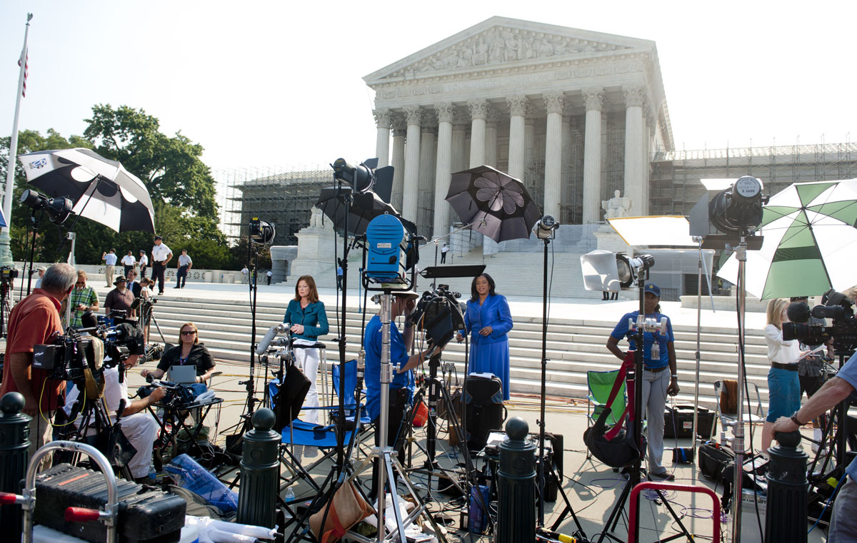 June 28, 2012: Reporters await a decision by the US Supreme Court on the constitutionality of the Affordable Healthcare Act, US President Barack Obama's signature healthcare legislation, outside the Supreme Court in Washington, DC, June 28, 2012. (Saul Loeb/AFP/Getty Images)